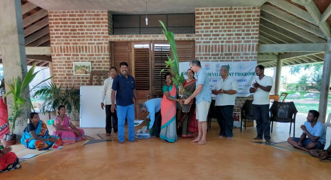 Mr. Paul Blanchflower, Director, Auroville Botanical Garden distributing saplings and gardening tool